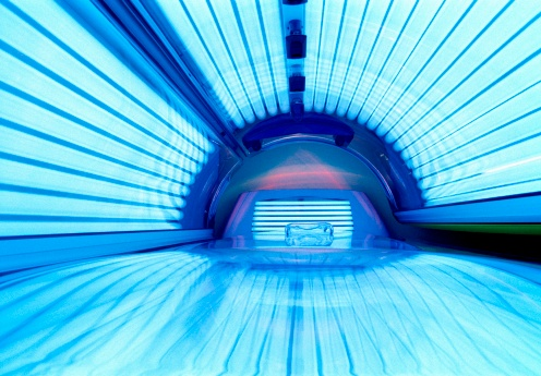 Illuminated tanning bed