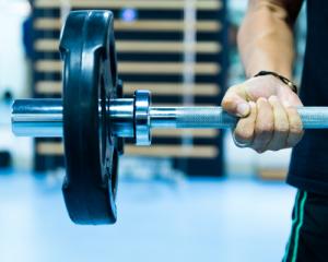 'man lifting weights'