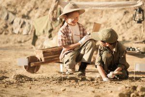 'children playing in dirt'