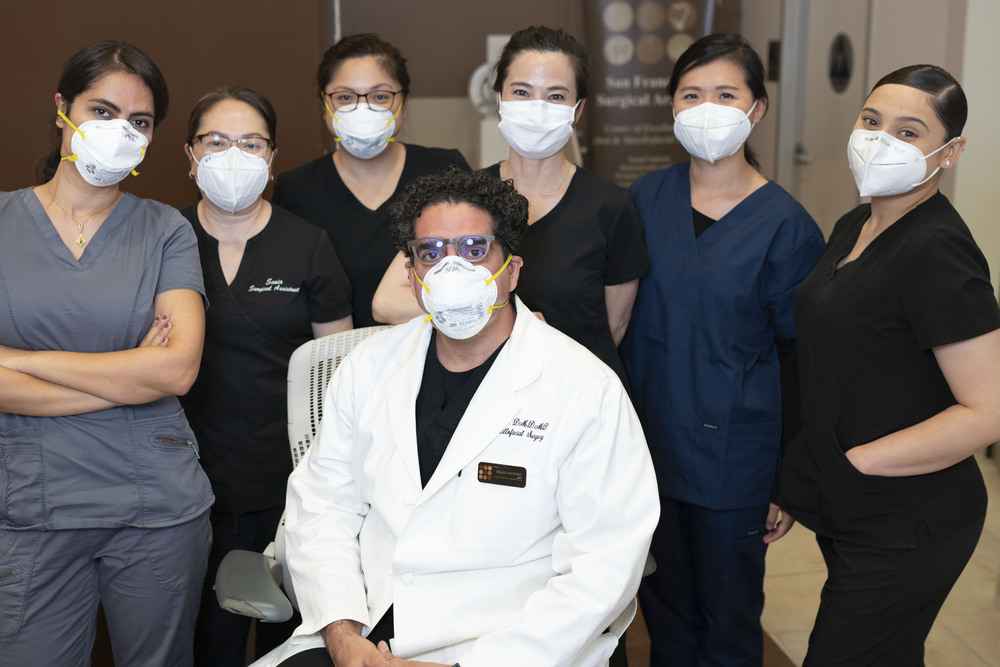 San Francisco oral surgeon Dr. Massoomi and his staff wearing masks to protect patients from COVID.